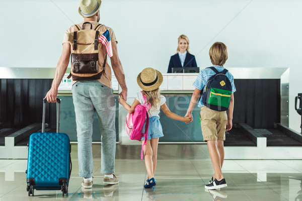 Stock photo: family going to check in desk