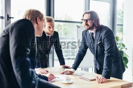 Stock fotó: üzletemberek · dolgozik · iroda · három · profi · papírok