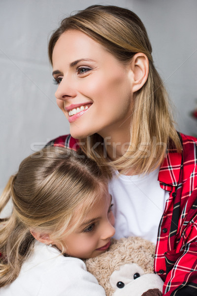 Stock photo: mother and daughter with teddy bear
