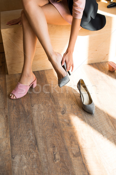 Stock photo: young woman choosing shoes