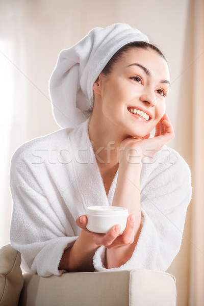 Stock photo: woman holding jar of cream