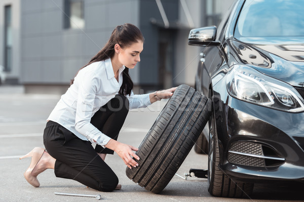 woman changing car tire Stock photo © LightFieldStudios