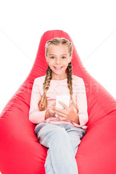 Criança jovem sessão vermelho saco de feijão Foto stock © LightFieldStudios