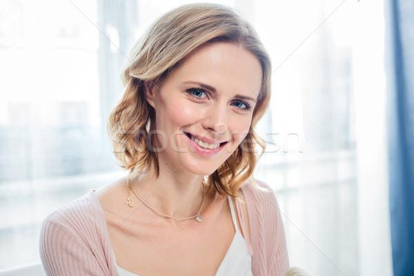 Mosolyog fiatal nő közelkép portré vonzó kamera Stock fotó © LightFieldStudios