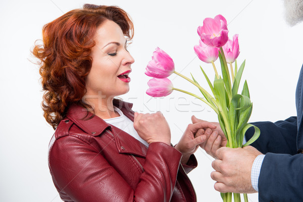 Man presenteren bloemen vrouw tulp verwonderd Stockfoto © LightFieldStudios