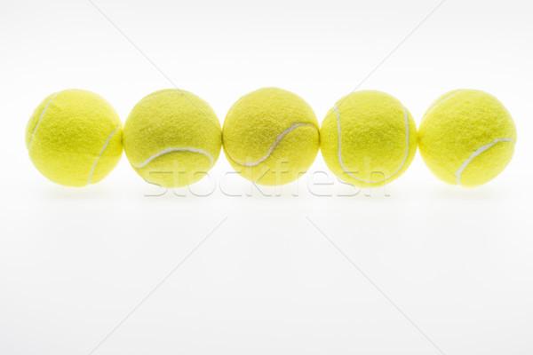 tennis balls in row Stock photo © LightFieldStudios