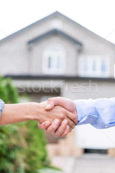 realtor and client shaking hands Stock photo © LightFieldStudios
