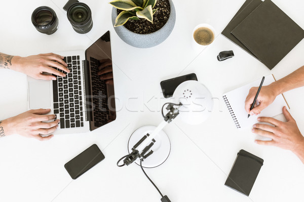 Men working with laptop and notepad Stock photo © LightFieldStudios