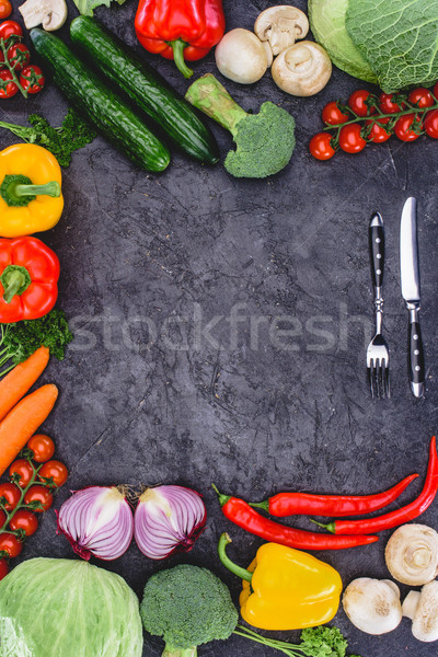 top view of fresh healthy organic vegetables and fork with knife on black Stock photo © LightFieldStudios