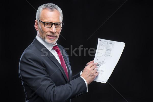 Businessman holding papers   Stock photo © LightFieldStudios