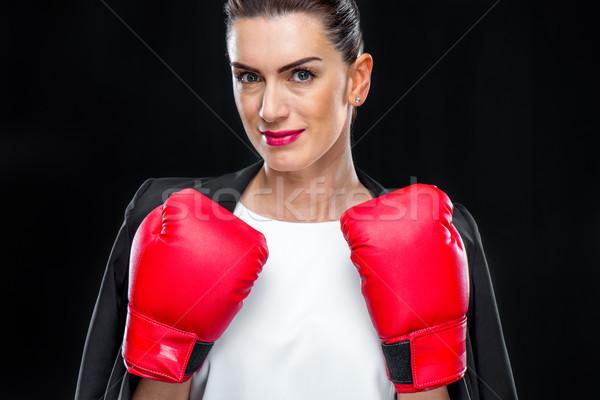 Businesswoman in boxing gloves Stock photo © LightFieldStudios
