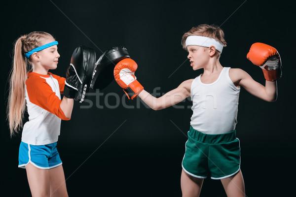 Seitenansicht Junge Mädchen Sportbekleidung Boxen isoliert Stock foto © LightFieldStudios