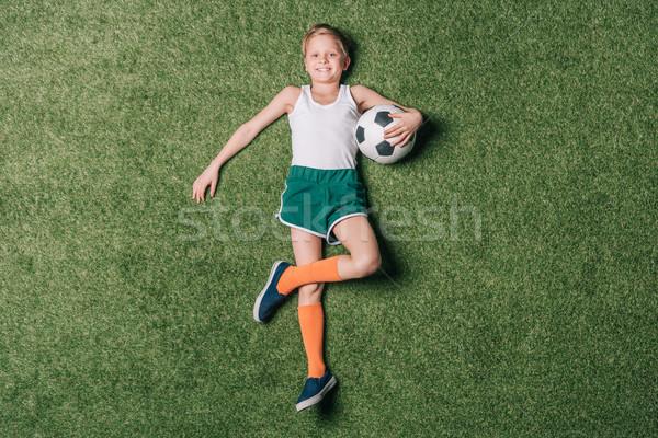 Top view piccolo ragazzo soccer ball Foto d'archivio © LightFieldStudios