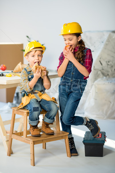 Kids eating in workshop Stock photo © LightFieldStudios