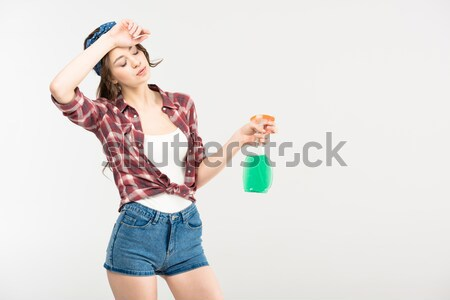 Young woman with spray bottle  Stock photo © LightFieldStudios