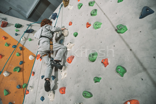 red-headed boy climbing wall Stock photo © LightFieldStudios