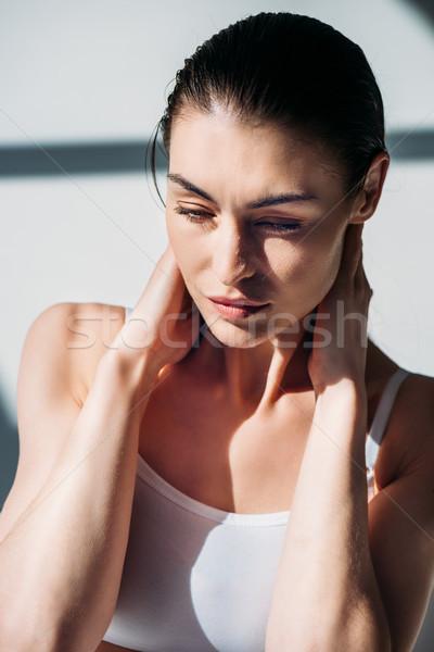 woman slicking back wet hair Stock photo © LightFieldStudios