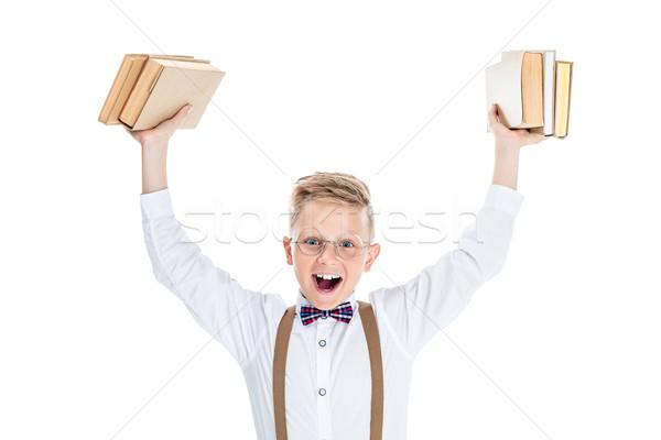 boy holding books Stock photo © LightFieldStudios