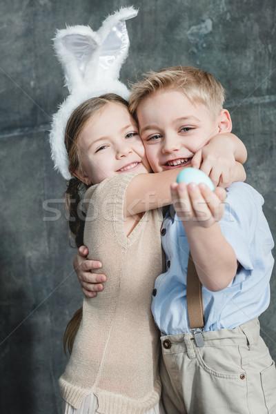Kids with easter egg Stock photo © LightFieldStudios