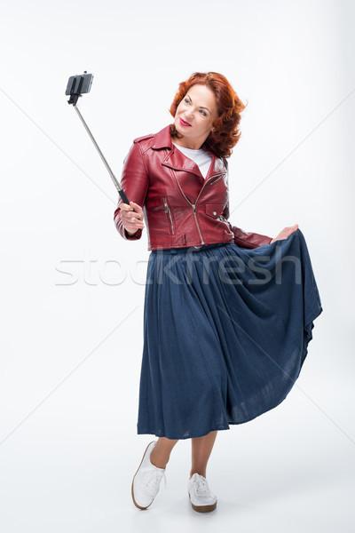 Woman taking selfie Stock photo © LightFieldStudios