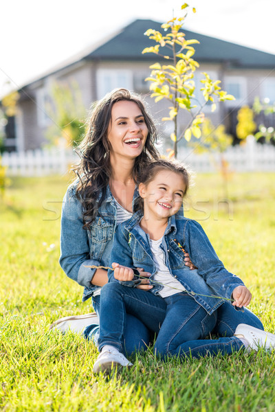 mother and daughter sitting on grass Stock photo © LightFieldStudios
