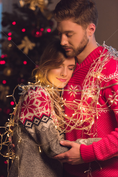 young couple with garlands Stock photo © LightFieldStudios