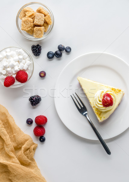 top view of piece of appetizing dessert with berries on white surface Stock photo © LightFieldStudios