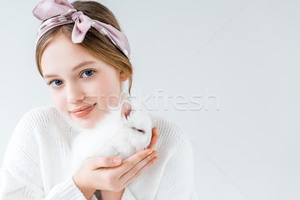Imádnivaló gyermek tart szőrös fehér nyúl Stock fotó © LightFieldStudios