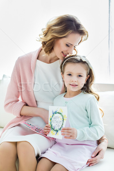 Beautiful mother and daughter with cards Stock photo © LightFieldStudios