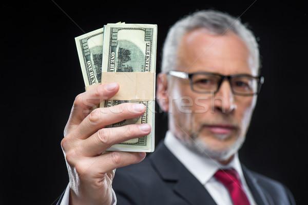 Businessman holding dollar banknotes Stock photo © LightFieldStudios