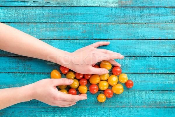 hands holding cherry-tomatoes Stock photo © LightFieldStudios