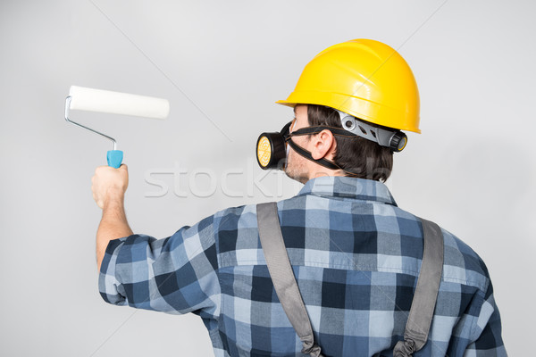 Construction worker with paint roller Stock photo © LightFieldStudios