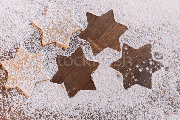 'Close-up top view of unbaked star shaped cookies in flour on table  Stock photo © LightFieldStudios
