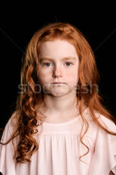 portrait of adorable upset redhead girl looking at camera isolated on black Stock photo © LightFieldStudios