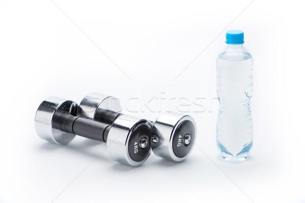 Metálico halteres garrafa água isolado branco Foto stock © LightFieldStudios