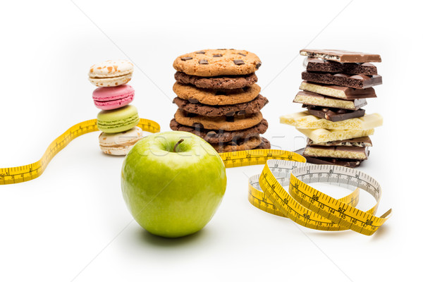 macaroons, cookies, chocolate bars, apple and measuring tape isolated on white Stock photo © LightFieldStudios