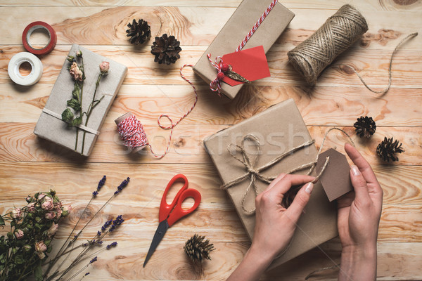 woman decorating christmas gift Stock photo © LightFieldStudios