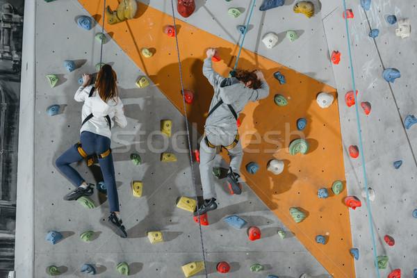 two little kids climbing wall with grips Stock photo © LightFieldStudios