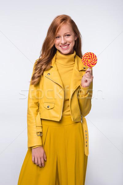 Nina amarillo chaqueta de cuero pirulí sonriendo Foto stock © LightFieldStudios