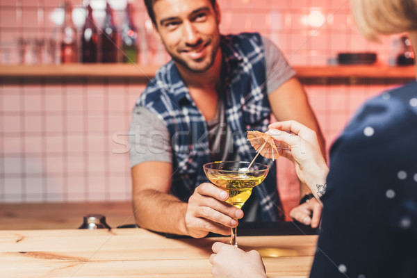 Stock photo: barman giving cocktail to visitor