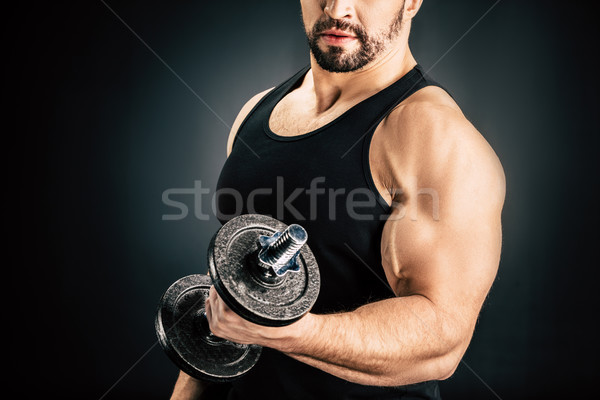 Homme muscles vue main isolé Photo stock © LightFieldStudios