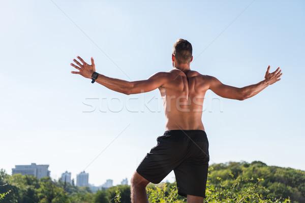 Torse nu célébrer triomphe vue arrière musculaire Photo stock © LightFieldStudios