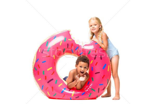 multiethnic kids with swim tube   Stock photo © LightFieldStudios