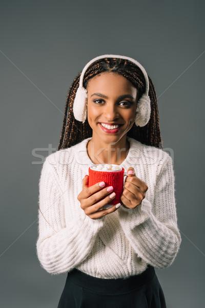 Lány iszik forró csokoládé gyönyörű afroamerikai mosolyog Stock fotó © LightFieldStudios