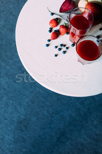 Rouge smoothie verres haut vue organique Photo stock © LightFieldStudios