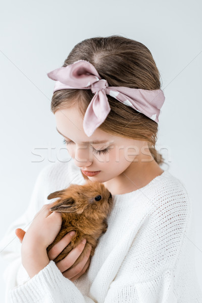 close-up view of beautiful teenage girl holding adorable furry rabbit isolated on white  Stock photo © LightFieldStudios