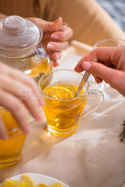 Woman mixing sugar in tea Stock photo © LightFieldStudios