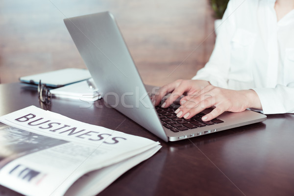 Close-up partial view of woman working with laptop  Stock photo © LightFieldStudios