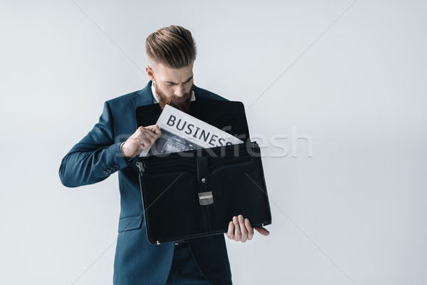 Barbudo jovem empresário jornal pasta negócio Foto stock © LightFieldStudios