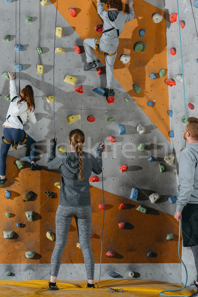 Two little kids climbing wall  Stock photo © LightFieldStudios